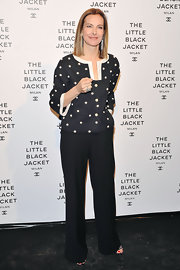 Carole Bouquet paired her fitted jacket with a pair of crisp, creased slacks for a totally sophisticated and chic look.