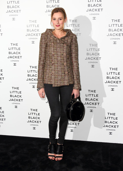Laura Carmichael carried a black round purse at the Chanel's private view of the Little Black Jacket.