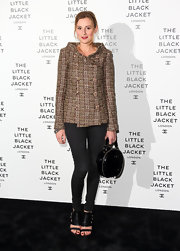 Laura Carmichael finished her look with a pair of leather gladiator heels at the Chanel private view.