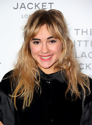 Suki styled her strands in messy unkempt waves with pushed-aside bangs for the Chanel Little Black Jacket preview in London.