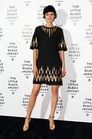 Stella's LBD at the Chanel party had an Egyptian vibe with its gold detailing.