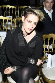 Kristen Stewart attended the Chanel Métiers d'art 2019 show wearing identical pearl bracelets on both wrists.