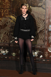 Kristen Stewart matched her top with a pair of black hot pants, also by Chanel.