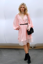 Lottie Moss was sweet and sultry at once in a pink lace-hem wrap dress by Chanel during the label's fashion show.