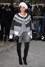 Miroslava Duma layered a patterned gray cardigan over a striped shirt for the Chanel fashion show.
