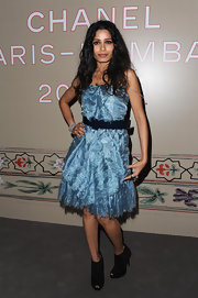 Freida Pinto was chic in blue at the Chanel show in Paris. She topped off her look with black ankle boots.