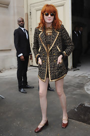 Florence dazzles in a matching coat and evening dress. The chunky gold embellishments are just her style.