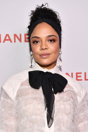 Tessa Thompson accessorized with an eye-catching pair of pearl and crystal drop earrings by Chanel.