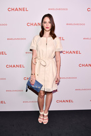 Kaya Scodelario complemented her dress with a pair of floral-embellished triple-strap sandals.
