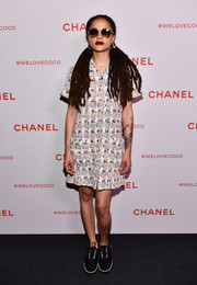 Sasha Lane kept it relaxed in this patterned tweed shirtdress by Chanel during the brand's Beauty House party.