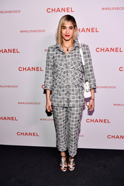 Sofia Boutella kept it business-like in a patterned gray pantsuit by Chanel during the brand's Beauty House party.