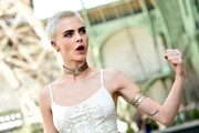 Cara Delevingne attended the Chanel Haute Couture show wearing a gold arm cuff.