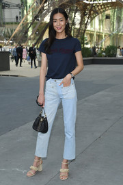 Liu Wen continued the casual vibe with faded blue jeans.