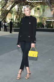 Pom Klementieff injected a nice pop of color with a quilted yellow purse by Chanel.
