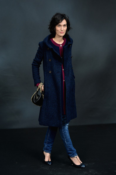 Clotilde Hesme showed her classic elegance at the Chanel runway show with a blue fitted wool coat.