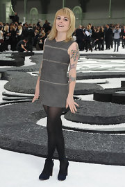 Beatrice Martin wore a sleeveless Chanel dress which showed off her bird tattoos.