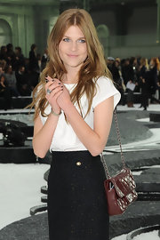 Clemence Posey showed off a burgundy quilted shoulder bag while hitting the Chanel Spring 2011 show.