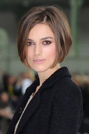 Keira Knightley showed off her newly shortened haircut while making an appearance at  Paris Fashion Week.