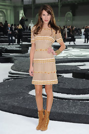 Caroline paired her whimsical dress with suede ankle boots.