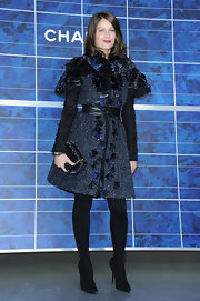 Laetitia Casta finished off her fashionable look with pointy-toe black pumps.
