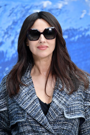 Monica Bellucci attended the Chanel Fall 2019 show wearing a loose center-parted hairstyle.