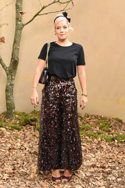 Lily Allen donned a pair of paillette palazzo pants by Chanel for a dressier finish.