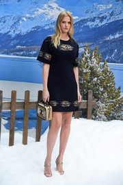Lara Stone attended the Chanel Fall 2019 show wearing a black logo mini dress from the brand.