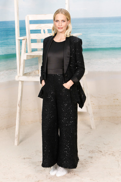 Poppy Delevingne looked smart in a sparkling black tweed suit at the Chanel Spring 2019 show.