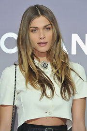 Elisa Sednaoui attended the Chanel fall 2012 ready-to-wear fashion show wearing her hair long and casually tousled.
