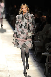 Anja Rubik walked the Chanel runway wearing glittery gray tights with a tweed skirt suit.