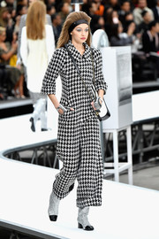 Gigi Hadid walked the Chanel show wearing a black-and-white houndstooth jumpsuit.