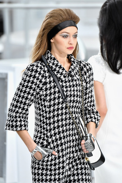 Gigi Hadid sported fingerless silver gloves at the Chanel Fall 2017 show.