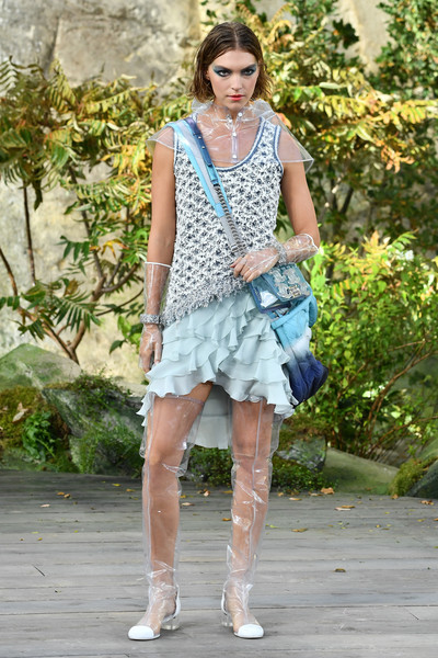 Arizona Muse looked feminine and flirty in a ruffle-hem cocktail dress while walking the Chanel show.