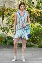 A blue cross-body bag finished off Arizona Muse's runway look.
