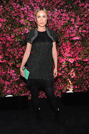 Radha Mitchell blended classic and contemporary with this black tweed frock.