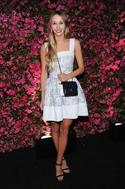 Harley Viera-Newton chose a fit-and-flare tweed dress for her look at the Chanel Tribeca Film Festival Artists Dinner.