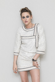 An elegant rectangle-faced watch with a chain and leather strap topped off Kristen Stewart's look.