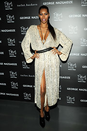 Jessica White channeled Bianca Jagger in this draped sequined dress for the Charity Meets Fashion Holiday Celebration.