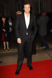 Colin Firth hit the red carpet in a sleek black suit complete with a relaxed shirt.