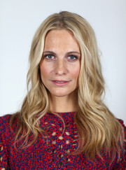 Poppy Delevingne let her hair down in barely there waves for the Charles Finch & Chanel Pre-BAFTA Party.