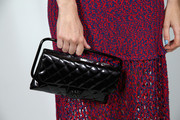 Poppy Delevinge carried a classic quilted Chanel clutch at the Charles Finch & Chanel Pre-BAFTA Party.