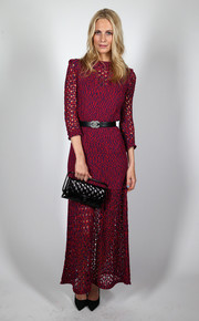 Poppy Delevingne wore a burgundy Chanel evening dress featuring cutout detailing for the Charles Finch & Chanel Pre-BAFTA Party.