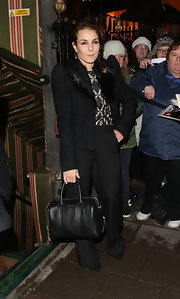 Noomi Rapace looked perfectly pulled together at the pre-BAFTA dinner with this black leather bowler bag and pantsuit combo.