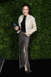 Michelle Yeoh shimmered in a champagne sequined jacket at the Charles Finch and Chanel pre-BAFTA dinner.