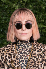 Noomi Rapace attended the Charles Finch and Chanel pre-BAFTA dinner wearing a bob with wispy bangs.