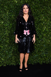 Salma Hayek donned a sequined Gucci LBD with a pink bow and buttons for the Charles Finch and Chanel pre-BAFTA dinner.
