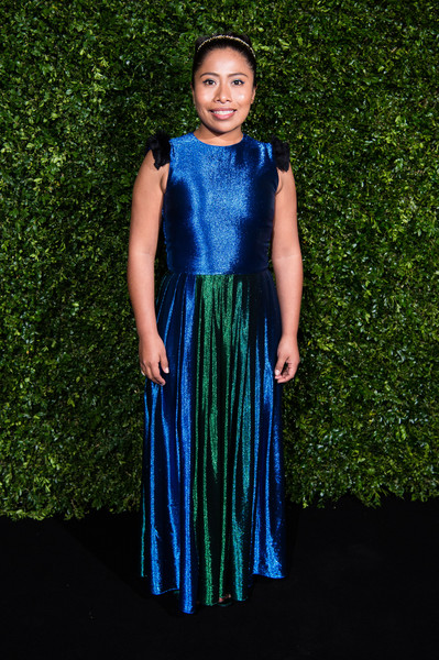 Yalitza Aparicio shimmered in a color-block gown by Kris Goyri at the Charles Finch and Chanel pre-BAFTA dinner.
