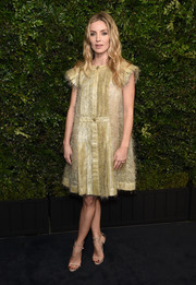 Annabelle Wallis attended the Charles Finch pre-Oscar dinner looking chic in a gold Chanel cocktail dress with pleated cap sleeves.