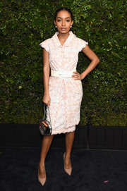 Yara Shahidi topped off her ensemble with a chic chain-strap bag by Chanel.