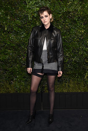 Kristen Stewart completed her outfit with a patterned mini skirt by Chanel.